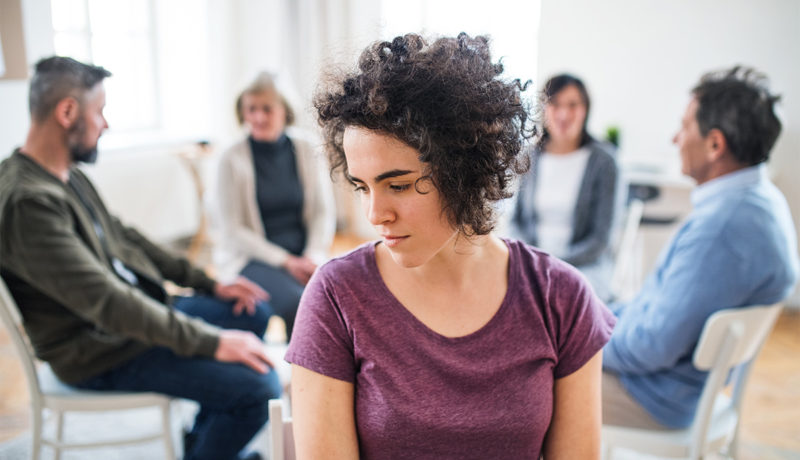 A young women at group therapy
